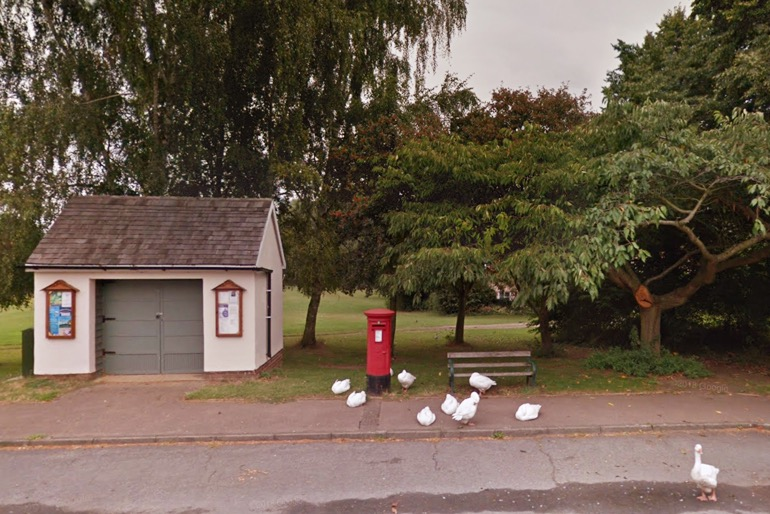 This image has an empty alt attribute; its file name is beyton-bus-shelter-and-trees.jpg